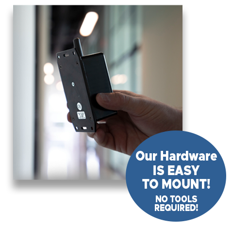 Image of High Level Wireless Panic Button being placed on a wall. Our Hardware Is Easy To Mount. No Tools Required.