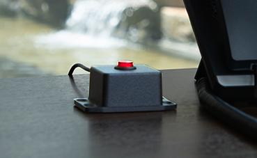 image of Silent Panic Button hardware sittin on a desk