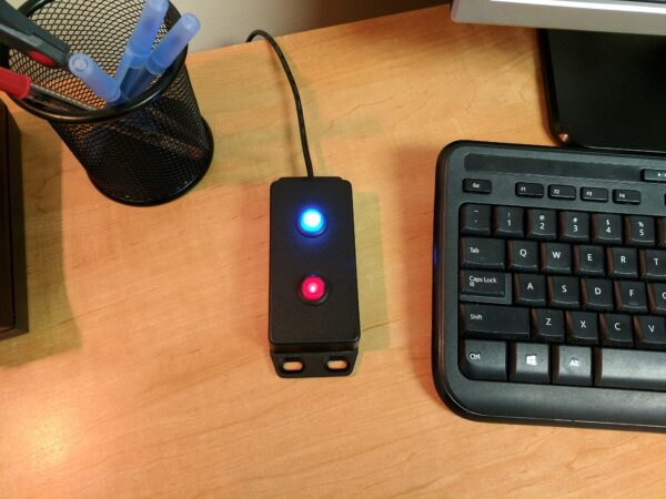 image of a wired panic button on a desk