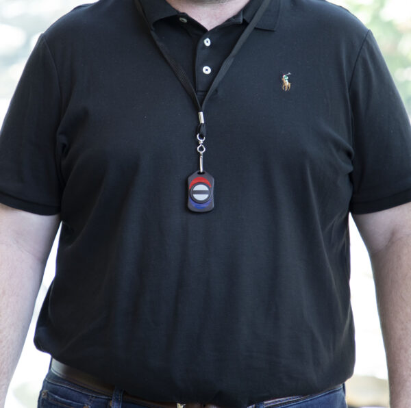 Image of a man wearing the wireless panic button on a lanyard around their neck